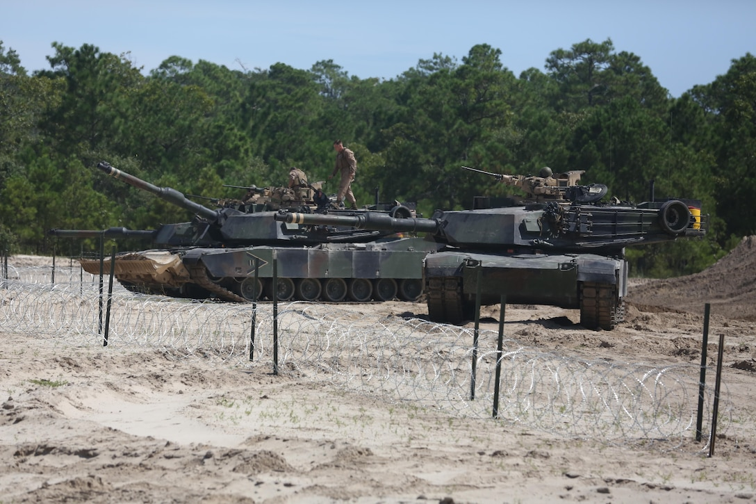 Marines with Mobility Assault Company, Combat Engineer Battalion, 2nd Marine Division exit their tanks at the completion of the breaching and clearing course September 12, 2013. Marines with Combat Engineer Battalion 2nd Marine Division participated in a week long field exercise in which they had to implement four basic combat engineer task being mobility, counter mobility, assault and general engineering.