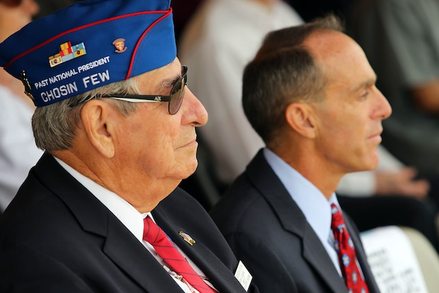 Bob Licker, left, listens to guest speakers during the 63rd Anniversary of the Landing on Inchon at the Chosin Few Monument adjacent to the Pacific Views Event Center here Sept. 13. Licker is a Korean War veteran and was apart of the Chosen Few. The ceremony for the 63rd Anniversary of the Landing on Inchon is also a time to commemorate those who gave their life during the conflict.