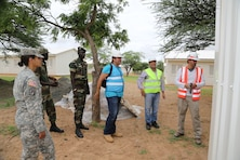 Representatives from the Senegalese armed forces, U.S. Embassy Senegal, U.S. Army Corps of Engineers Europe District and contractor, CNaf-SET, tour the Dodji Peace Keeping Operations Training Center project site Aug. 20 in Senegal. The camp is being upgraded to include eight new barracks, a dining facility, shower and latrine facilities for men and women, a water treatment plant and a well. The turnkey facilities will accommodate and supply 1,000 soldiers upon completion mid-September. U.S. Department of State Global Peace Operations Initiative funded the project to support the development of Senegalese PKO capabilities.