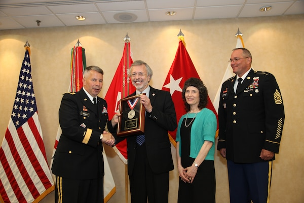 IWR and ICIWaRM Director Robert Pietrowsky accepts the 2013 LTG John W. Morris Civilian of the Year Award at the National Awards Dinner. Left to right: Major General Todd T. Semonite, Robert A. Pietrowsky, Camille Torquato, Command Sergeant Major Karl J. Groninger