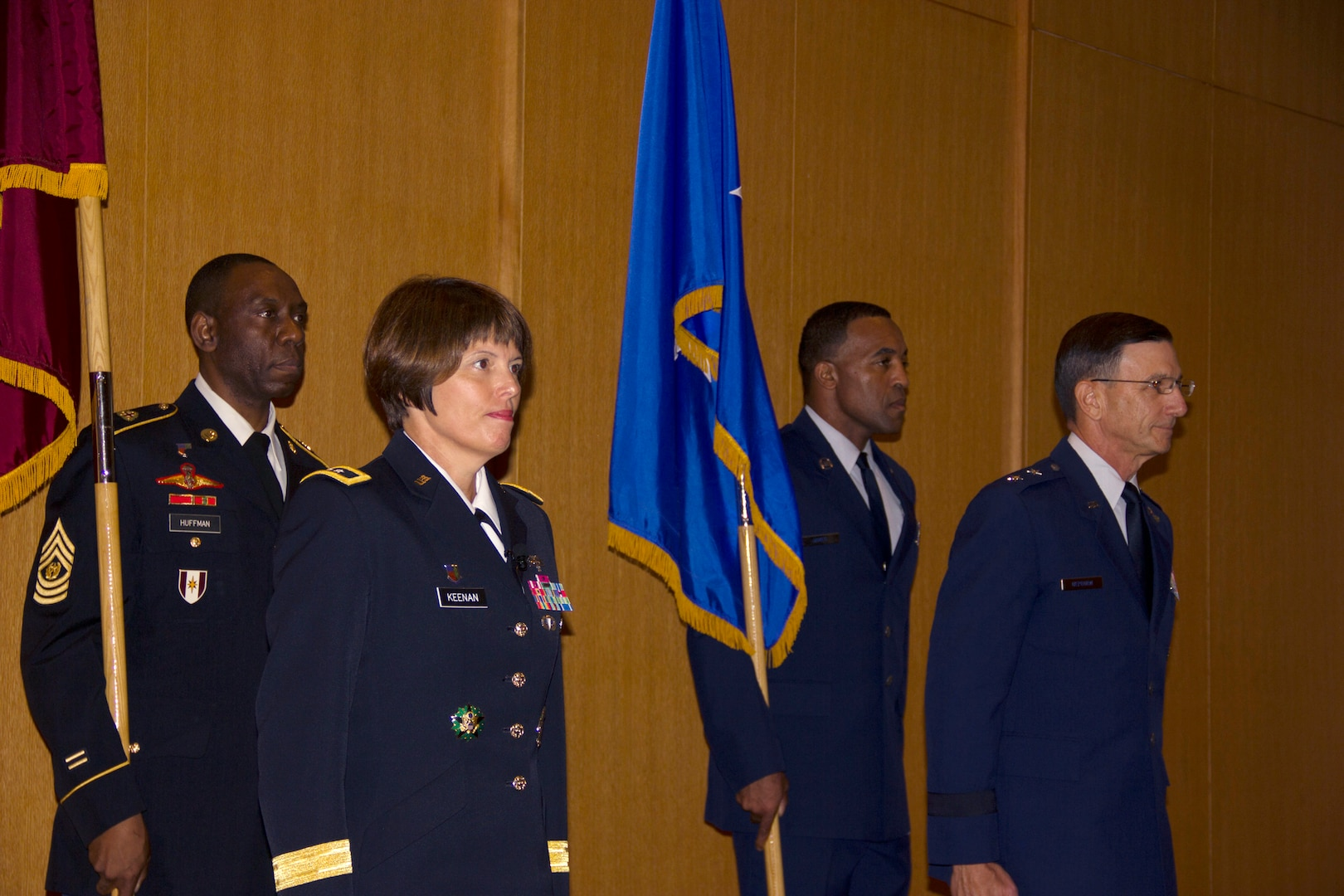 In a ceremony held at San Antonio Military Medical Center, Army Maj. Gen. Jimmie O. Keenan, front left, assumed authority as the director of the San Antonio Military Health System from Air Force Maj. Gen. Byron C. Hepburn, front right, who will now serve as the deputy director. During the transfer of authority, the senior enlisted advisors, Army Command Sergeant Major Marshall L. Huffman, back left, and Air Force Chief Master Sergeant Maurice A. James, back right, follow the generals as they trade places, symbolically marking the transfer of leadership from Air Force to Army.  (U.S. Army photo by Erin Perez/Released)