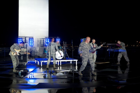 "Members of Max Impact on location at a video shoot of their new song, ""Stand."" (U.S. Air Force photo/Senior Master Sgt. Robert Kamholz)"