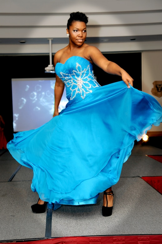 Nia Newton, 509th Force Support Squadron and fashion show model, twirls in a Cinderella's Closet dress during the B-2 Fabulous Fashion Show at Whiteman Air Force Base, Mo. Sept.  6, 2013. The Cinderella's Closet has dresses available for any event, be it a wedding or a military ball. (U.S. Air Force photo by Airman 1st Class Shelby R. Orozco/Released)