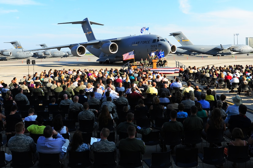An audience listens to guest speakers during a ceremony held to commemorate the delivery of the final U.S. Air Force C-17 Globemaster III, P-223,  Sept. 12, 2013, on the flight line at JB Charleston - Air Base, S.C. This historical event comes more than 20 years after the 437th Airlift Wing and the 315th Airlift Wing took delivery of the very first C-17 to enter the Air Force inventory June 14, 1993 and marks the successful completion of C-17 production for the U.S. Air Force. (U.S. Air Force photo/ Airman 1st Class Chacarra Neal)