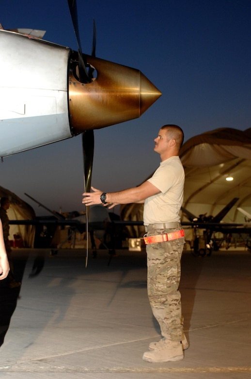 Staff Sgt. Tyler Groff, 451st Expeditionary Aircraft Maintenance Squadron dedicated crew chief, checks the propeller of an MQ-9 Reaper before a flight Aug. 27, 2013, at Kandahar Airfield, Afghanistan. Members of the 451st EAMXS are responsible for maintenance, launch and recovery for MQ-1 and MQ-9 aircraft.