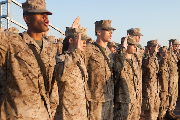 New Marines of Delta Company, 1st Recruit Training Battalion, renew the oath of enlistment during a ceremony in which they received their Eagle, Globe and Anchor emblems Sept. 7, 2013, at the Iwo Jima flag raising statue on Parris Island, S.C. This ceremony marks the end of the 54-hour culminating event of training known as the Crucible and is the first time recruits are called Marines. Delta Company is scheduled to graduate Sept. 13, 2013. Parris Island has been the site of Marine Corps recruit training since Nov. 1, 1915. Today, approximately 20,000 recruits come to Parris Island annually for the chance to become United States Marines by enduring 13 weeks of rigorous, transformative training. Parris Island is home to entry-level enlisted training for 50 percent of males and 100 percent for females in the Marine Corps. (Photo by Lance Cpl. MaryAnn Hill)