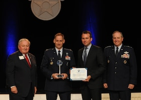 Lt Col. Grant Hargrove is presented the International Affairs Excellence Award by Acting Air Force Secretary Eric Fanning, Air Force Chief of Staff Gen. Mark A. Welsh III and George K. Muellner at the Air Force Association's 2013 Air & Space Conference and Technology Exposition Sept. 16, 2013, in Washington, D.C. The International Affairs Excellence Award is presented annually for outstanding and innovative contributions effective in building, sustaining, expanding and guiding Air Force-to-partner relationships. Muellner is the Air Force Association chairman of the board.  (U.S. Air Force photo/Airman 1st Class Aaron Stout)