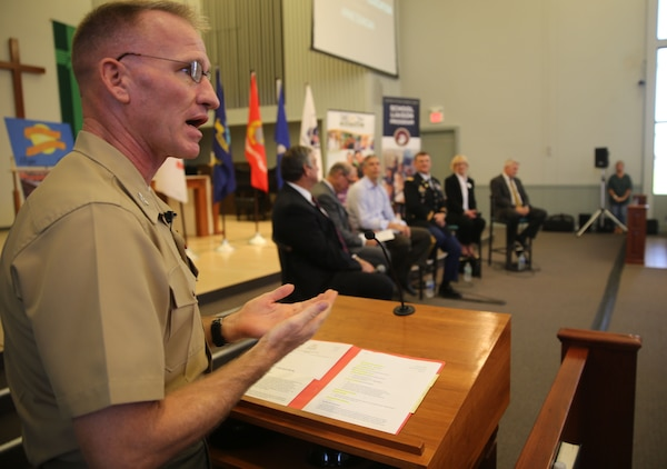 Commanding Officer of Marine Corps Air Station Yuma, Ariz., Col. Robert Kuckuk, moderates a panel of education leaders aboard Marine Corps Air Station Yuma, Ariz., Thursday. The town hall took place at the station chapel in front of a crowd of military parents and local teachers in order to address concerns and instill further confidence in the local military community. Topics included the rising costs of education and the challenges military children encounter through their academic career.