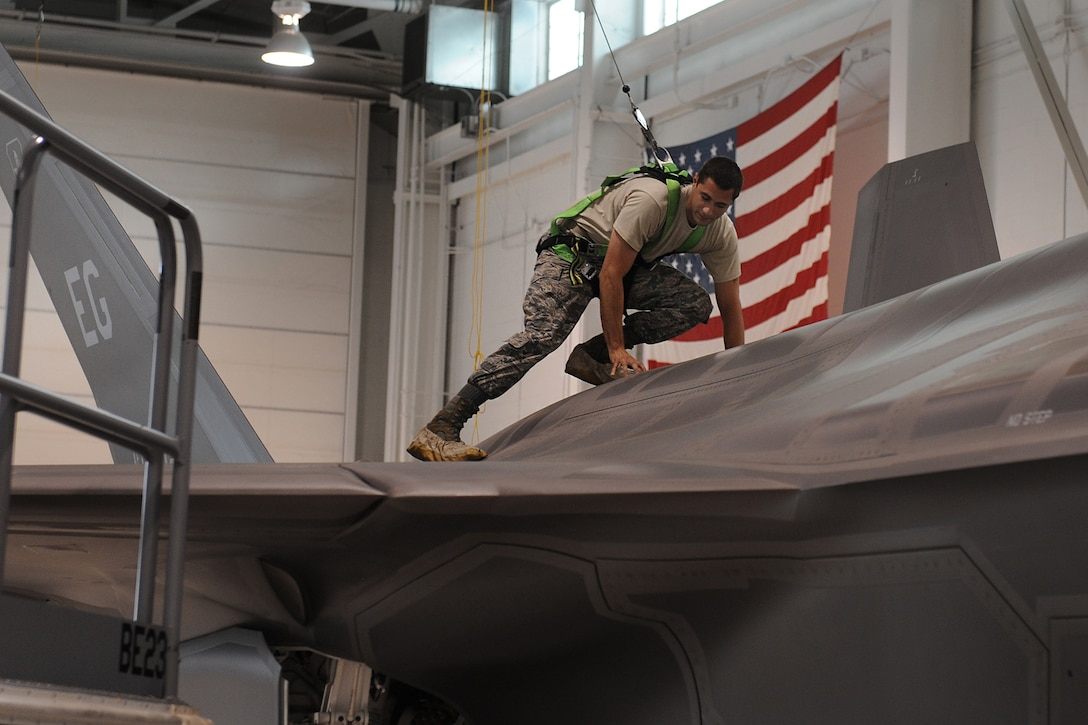 Staff Sgt. Danny Pereira provides maintanance on the F-35 Lightning II during operations June 20, 2013, at Eglin Air Force Base, Fla. The F-35 will be used by the Air Force, Navy, Marine Corps and other partner nations.
