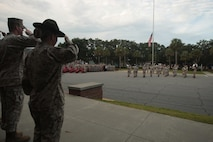 Marines from across Parris Island, S.C., salute the nation's flag Sept. 11, 2013, during a commemorative ceremony dedicated to the lives lost on 9/11. Terrorist attacks 12 years ago killed approximately 3,000 people, making it the greatest tragedy on U.S. soil since the Japanese attack on Pearl Harbor in 1941. (Photo by Cpl. Caitlin Brink)