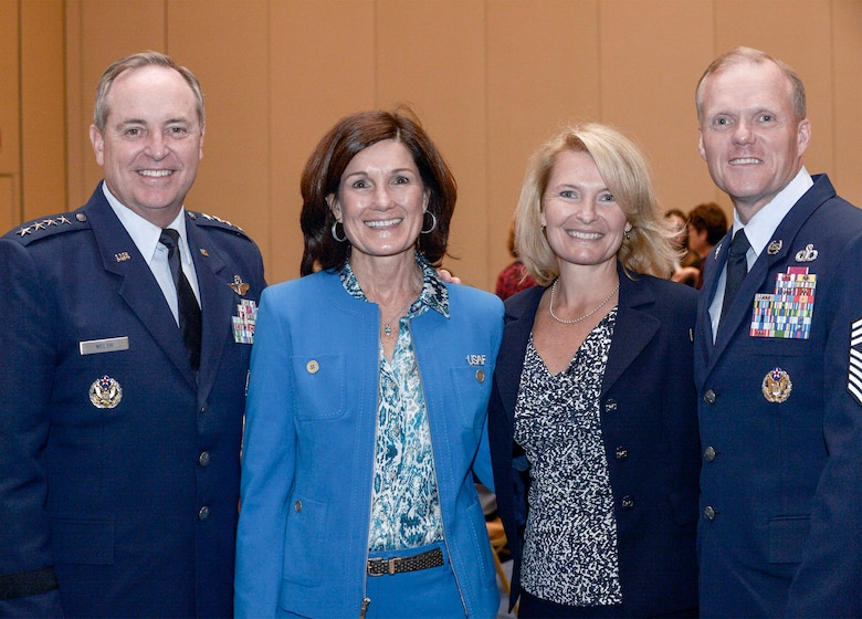 Air Force Chief of Staff Gen. Mark A. Welsh III, (left to right) his wife Betty, Athena Cody and Chief Master Sgt. of the Air Force James A. Cody pose for a photo at the Air Force Association's 2013 Air & Space Conference and Technology Exposition Sept.16, 2013, in Washington D.C. Betty and Athena addressed Family Spouse Forum attendees concerning unique issues facing military spouses and family members such as multiple deployments, child care and education. (U.S. Air Force photo/Michael J. Pausic)