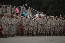 Marines from across Parris Island, S.C., bow their heads Sept. 11, 2013, during a moment of silence as part of a commemorative ceremony dedicated to the lives lost on 9/11. Terrorist attacks 12 years ago killed approximately 3,000 people, making it the greatest tragedy on U.S. soil since the Japanese attack on Pearl Harbor in 1941. (Photo by Cpl. Caitlin Brink)