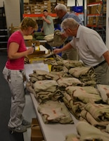 Deployees are issued uniforms and boots at the USACE Deployment Center as they prepare to deploy in support of contingency operations in the Middle East and Central Asia.