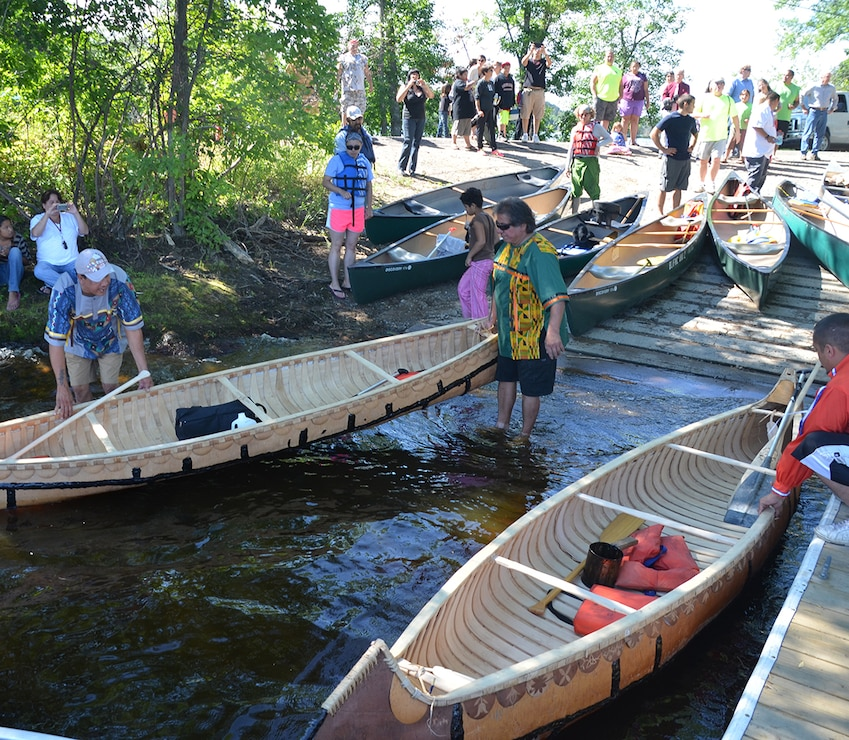 MCGREGOR, Minn. -- Members of the St. Croix Ojibwe Tribe launch their hand-made birchbark canoes at Big Sandy Lake, near McGregor, Minn., July 31. About 200 people gathered to remember the more than 400 Anishinaabe people that died during the winter of 1850-1851. (Photo by Patrick Moes)