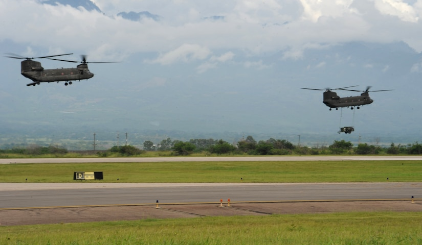 Two 1-228 Aviation Battalion Chinook-47's depart here carrying medical personnel and equipment from Joint Task Force-Bravo's Medical Element and from the Honduran Ministry of Health Sept 16, 2013. The post conducts MSTs to enhance relations through medical assistance with regional and local civilian organizations while supporting the Ministry of Health's efforts to provide medical care to the population.