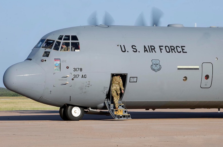 One last U.S. Air Force Airman boards a C-130 J-model before take-off Sept. 3, 2013, at Dyess Air Force Base, Texas. The 39th Airlift Group recently deployed in support of U.S. Central Command missions. While deployed, Airmen will support theater commander's requirements with combat-delivery capability through tactical airland and airdrop operations as well as humanitarian efforts and aeromedical evacuation. (U.S. Air Force photo by Airman 1st Class Kylsee Wisseman)
