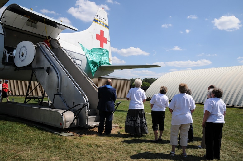 The members of the St. Paul based, Minnesota Air Guard, 109th Aeromedical Evacuation Squadron participated in a founders reunion on Aug 17, 2013. The reunion included an unveiling of a Red Cross on the base's Convair C‐131 in honor of Col. Maureen A. Hunt, former Strategic Air Command, Chief Nursing Services and her lasting impact on the 109th Aeromedical Evacuation Squadron.