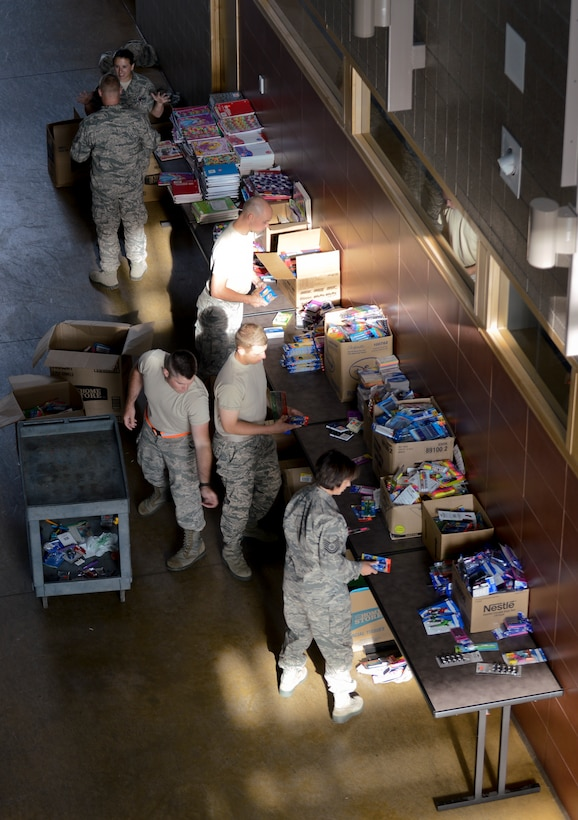 Airmen from the 133rd Airlift Wing volunteer to sort school supplies in St. Paul, Minn., Aug. 15, 2013. The school supplies were donated from customers at Dollar Trees stores throughout the Twin Cities area in support of Operation Homefront and the Back-to-School-Brigade.    (U.S. Air National Guard photo by Tech. Sgt. Amy M. Lovgren/ Released)   (U.S. Air National Guard photo by Tech. Sgt. Amy M. Lovgren/ Released)