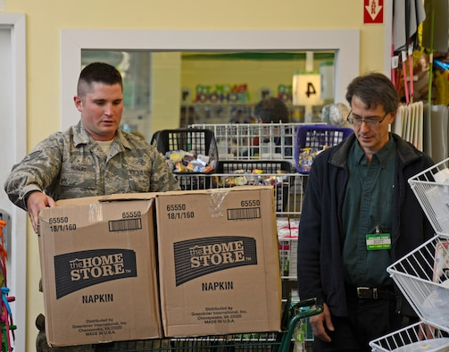 Staff Sgt. James Hubert, 133rd Logistics Readiness Squadron, collects boxes filled with school supplies in Minneapolis, Minn., Jul. 24, 2013. Hubert took on the role as lead coordinator to organize the pick-up, sorting, and distribution of school supplies donated from customers at Dollar Tree stores throughout the Twin Cities area in support of Operation Homefront and the Back-to-School-Brigade.  