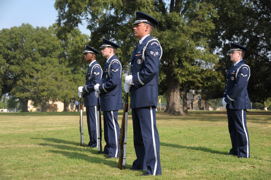 Maxwell Air Force Base Honor Guard perform a memorial ceremony held Sept. 16, 2013 at Maxwell Air Force Base. A wreath was posted as a part of the ceremony to remember POW/MIAs. (U.S. Air Force by Master Sgt. Michael Voss)