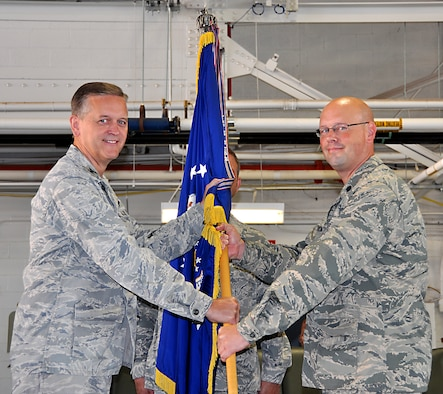 Lieutenant Colonel Travis Caughlin, right, accepts command from Col. Russell Muncy, 507th Air Refueling Wing commander during a change of command ceremony held here September 8, 2013.  Caughlin comes to the 507th Maintenance Group after serving as deputy commander for maintenance, 917th Fighter Group, Barksdale AFB La.  (U.S. Air Force photo/Senior Airman Mark Hybers)