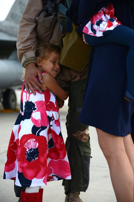 SPANGDAHLEM AIR BASE, Germany – Abigail Chalverus, daughter of U.S. Air Force Lt. Col. Marshall Chalverus, 480th Fighter Squadron leadership from Seattle, hugs her father during a deployment homecoming Sept. 15, 2013. More than 100 friends, family and Airmen showed up to support the event. (U.S. Air Force photo by Airman 1st Class Gustavo Castillo/Released)