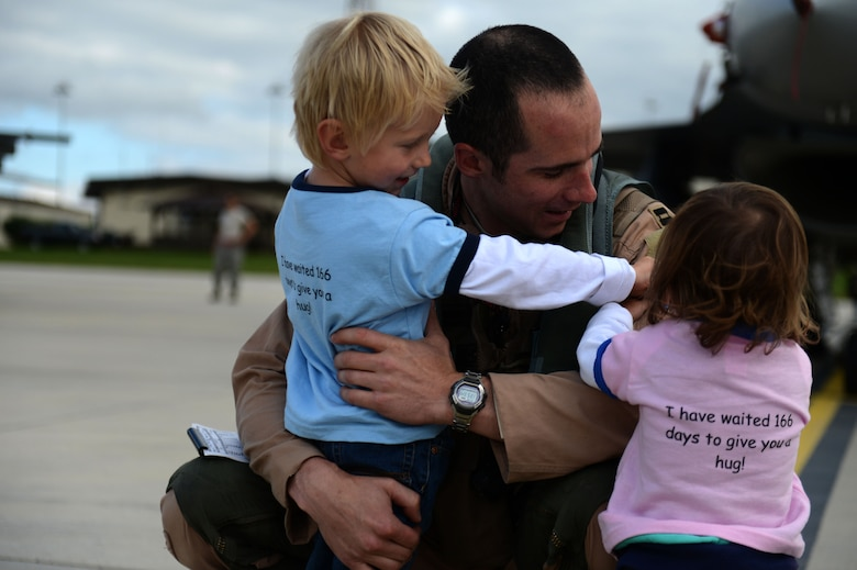 SPANGDAHLEM AIR BASE, Germany – U.S. Air Force Capt. Lance Ferguson, 480th Fighter Squadron pilot from Adrian, Mich., greets his family Sept. 15, 2013, after the squadron's deployment to an undisclosed location in Southwest Asia. The 480th FS Airmen and aircraft deployed in support of Operation Enduring Freedom. (U.S. Air Force photo by Airman 1st Class Gustavo Castillo/Released)