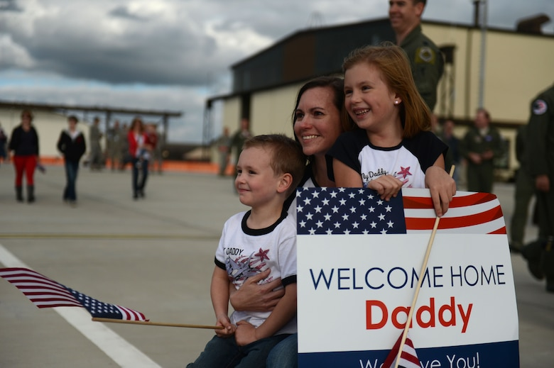 SPANGDAHLEM AIR BASE, Germany – Lisa Boland, and her children Carter and Rylie, wait in suspense during a deployment homecoming Sept. 15, 2013. More than 100 friends, family and Airmen showed up to support the event. (U.S. Air Force photo by Airman 1st Class Gustavo Castillo/Released)