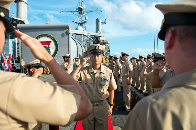 u s department of > photos > photo essays > essay view newly pinned u s navy chief jose r rayos salutes the commanding officer and command master