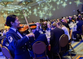 The United States Air Force Band performs during the Outstanding Airmen of the Year reception and awards dinner hosted by the Air Force Association during the AFA's annual Air & Space Conference and Technology Exposition Sept. 16, 2013, in Washington, D.C. The OAY award recognizes the top 12 outstanding enlisted Airmen for superior leadership, job performance, community involvement, and personal achievements. The program was initiated at the Air Force Association's 10th annual national conference, held in New Orleans in 1956.(U.S. Air Force photo/Jim Varhegyi)