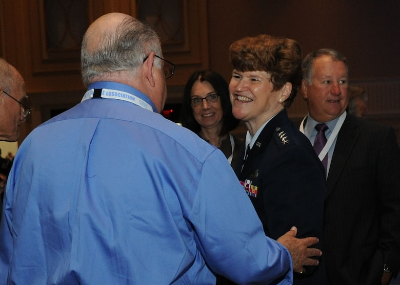Gen. Janet C. Wolfenbarger interacts with attendees after her speech at the 2013 Air & Space Conference and Technology Exposition, Sept. 16, 2013, in Washington, D.C. Wolfenbarger shared her insight on her command's contributions to sustaining the force in a presentation to conference attendees. Wolfenbarger is the commander of Air Force Materiel Command at Wright-Patterson Air Force Base, Ohio. (U.S Air Force photo/Airman 1st Class Nesha Humes)