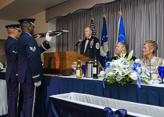 Chief Master Sgt. of the Air Force James Cody inducts the former Secretary of the Air Force Michael Donley into the Order of the Sword during a ceremony on Joint Base Anacostia Bolling, Washington, D.C. on Sept. 13, 2013.