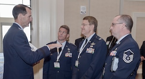Lt. Gen. Stanley E. Clarke (left) meets with members of the New York Air National Guard after his presentation at the Air Force Association's 2013 Air & Space Conference and Technology Exposition Sept. 17, 2013, in Washington, D.C. Clarke is the director of the Air National Guard. (U.S. Air Force photo/Michael J. Pausic )