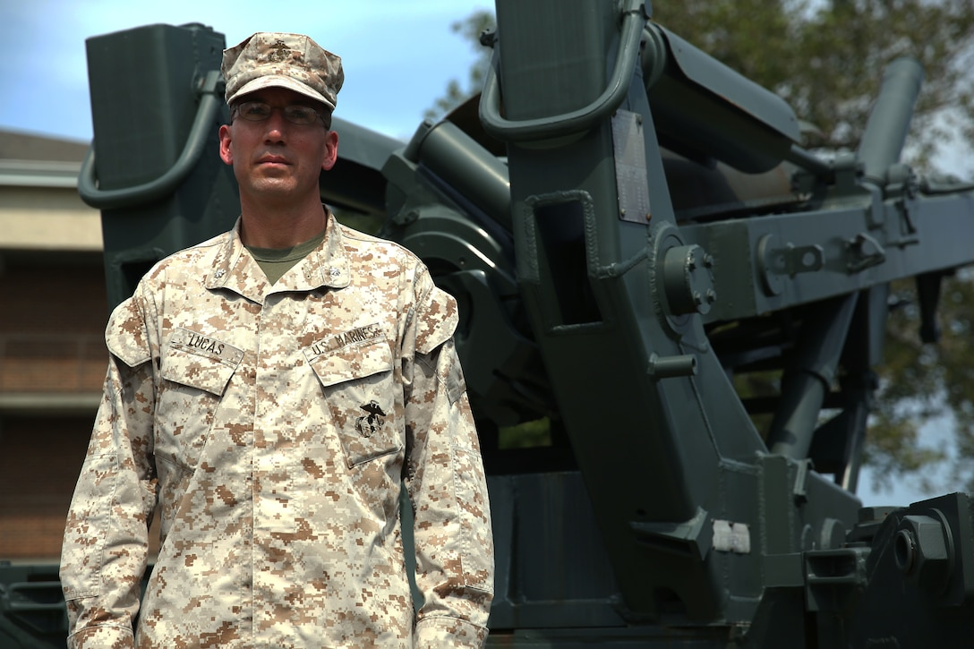 Lieutenant Col. Dave Lucas, the 10th Marine Regiment, 2nd Marine Division executive officer, stands in front of an M198 Howitzer, Sept. 14, 2013, aboard Marine Corps Base Camp Lejeune. Lucas is retiring Nov. 1, and is having his retirement ceremony Sept. 20.