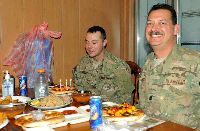 Lt. Col. Jonathon McBeth and his son, Senior Airman Jonathan McBeth, share a birthday meal together on Bagram Airfield, Afghanistan, Sept. 17, 2013.