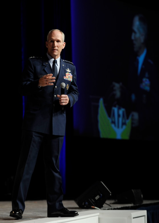 """Gen. Mike Hostage addresses audience members during his """"Combat Forces in the 2020's"""" speech at the Air Force Association's 2013 Air & Space Conference and Technology Exposition Sept. 17, 2013, in Washington, D.C. A majority of Hostage's comments were focused around aircraft, though he stated that the most powerful resource is Airmen.  Hostage is the Air Combat Command commander. (U.S Air Force photo/Airman 1st Class Nesha Humes)"""