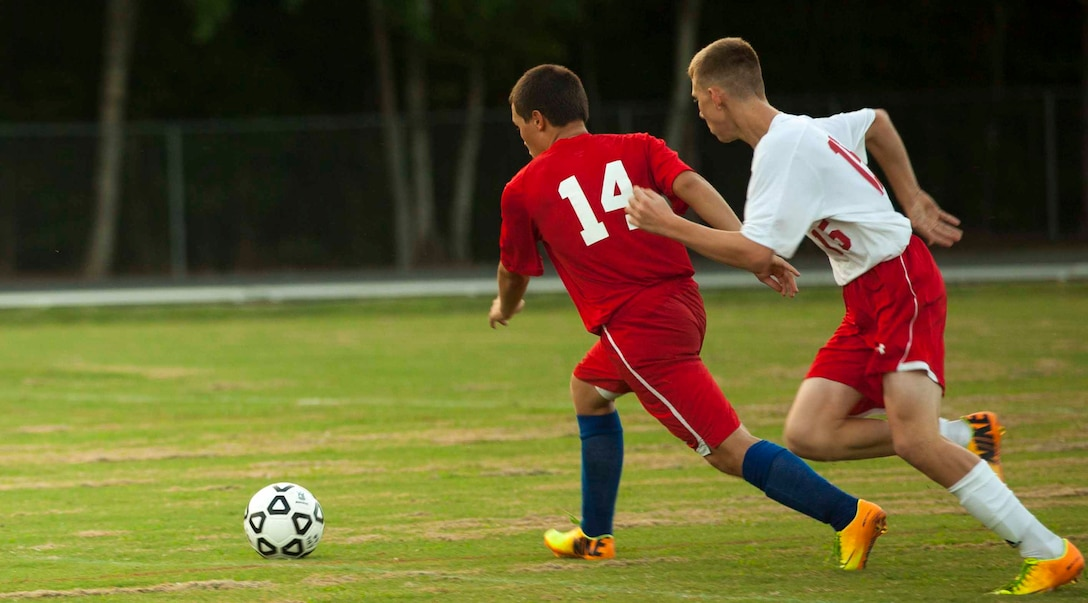 John Cooling, sophomore soccer player for the Lejeune Devilpups, attempts to reach the soccer ball before his opponent during a varsity soccer match against the Pender Patriots aboard Marine Corps Base Camp Lejeune, Sept. 12.