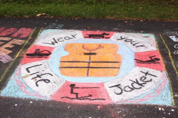 Alison Shope of Huntingdon, Pa., placed third in her age group for the masterpiece she created using only chalk to encourage visitors to wear life jackets during a variety of water activities at the lake and to also use one for their pets.