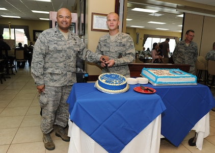 To celebrate the Air Force's 66th birthday U.S. Air Force Lt. Col. William Wade, Joint Task Force-Bravo deputy commander, and one of 612th Air Base Squadron's junior Airmen, Airman 1st Class Chad Behr, 612th ABS crew chief, cut the Air Force cake here Sept 18, 2013. Initially part of the U.S. Army Air Corps, the now U.S. Air Force, was made into its own military branch on Sept 18, 1947 under the National Security Act of 1947. The U.S. Air Force is one of the strongest and most technologically advanced forces on the planet.