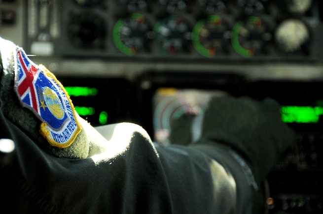 BIRMINGHAM, Ala. -- Lt. Col. Michael Phillips adjusts KC-135R throttles during five-ship mission here on Saturday. The purpose of this mission was training. Four of the KC-135s refueled A-10 aircraft. The fifth KC-135R returned to base after the formation training was complete. A KC-135R from the 171st Air Refueling Wing in Pittsburgh, Pa. was flown in the formation and was used during the refueling mission. (U.S. Air National Guard photo by Tech. Sgt. Jon Roebuck/Released)