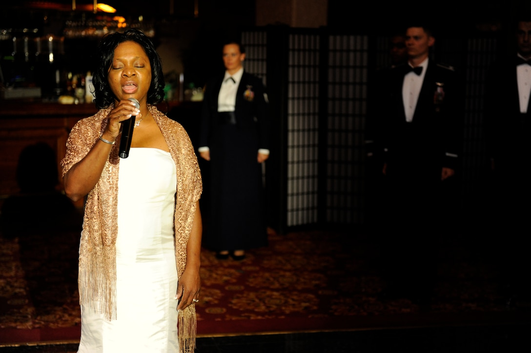 """Aretha Neal sings the U.S. national anthem, """"The Star Spangled Banner,"""" preceding the 2013 Air Force  Ball on Kadena Air  Base, Japan, Sept. 14, 2013. The 2013 Air Force Ball, which was themed """"Shaping Airpower with Innovation,"""" signified the 66th nniversary of the U.S. Air Force. (U.S. Air Force photo by Senior Airman Maeson L. Elleman)"""