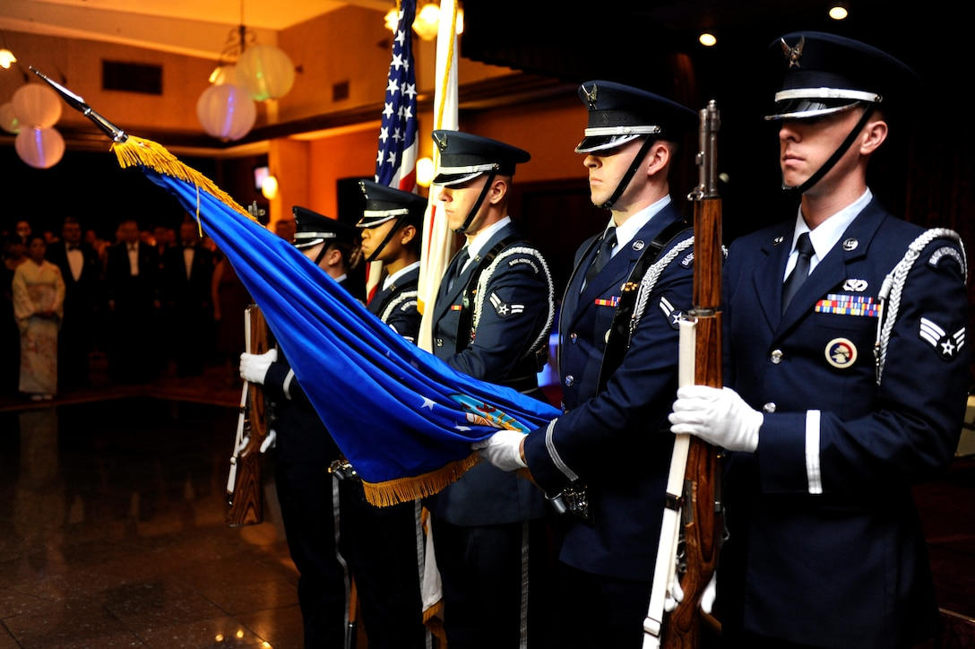 """U.S. Air Force Airmen from the Kadena Honor Guard, present the colors during the U.S. and Japanese national anthems preceding the 2013 Air Force ball on Kadena Air Base, Japan, Sept. 14, 2013. This year's theme, """"Shaping Airpower with Innovation,"""" honored the people and events that shaped the Air Force through creativity. (U.S. Air Force photo by Senior Airman Maeson L. Elleman)"""