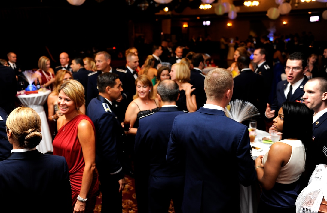 """Members attending the 2013 Air Force Ball on Kadena Air Base, Japan, mingle during the event Sept. 14, 2013. This year's theme, """"Shaping Airpower with Innovation,"""" signified the 66th Anniversary of the U.S. Air Force. (U.S. Air Force photo by Senior Airman Maeson L. Elleman)"""
