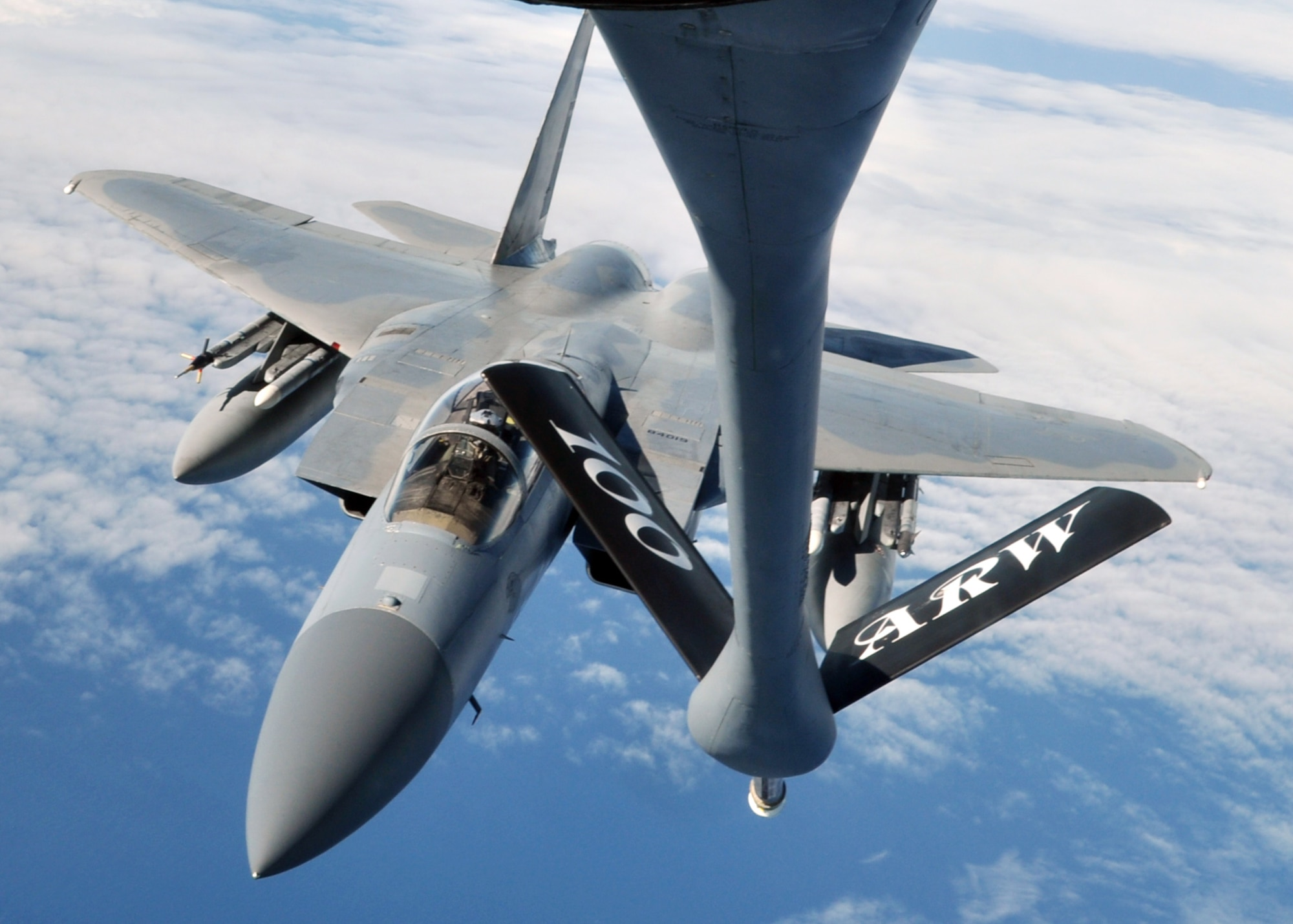 A U.S. Air Force F-15C Eagle finishes refueling with a U.S. Air Force KC-135R Stratotanker Sept. 12, 2013, en route to the Arctic Challenge exercise. The F-15C, in coordination with fighters from Norway, Sweden, Finland and the U.K., provided the air-to-air attack element in many of the scenarios during the exercise.