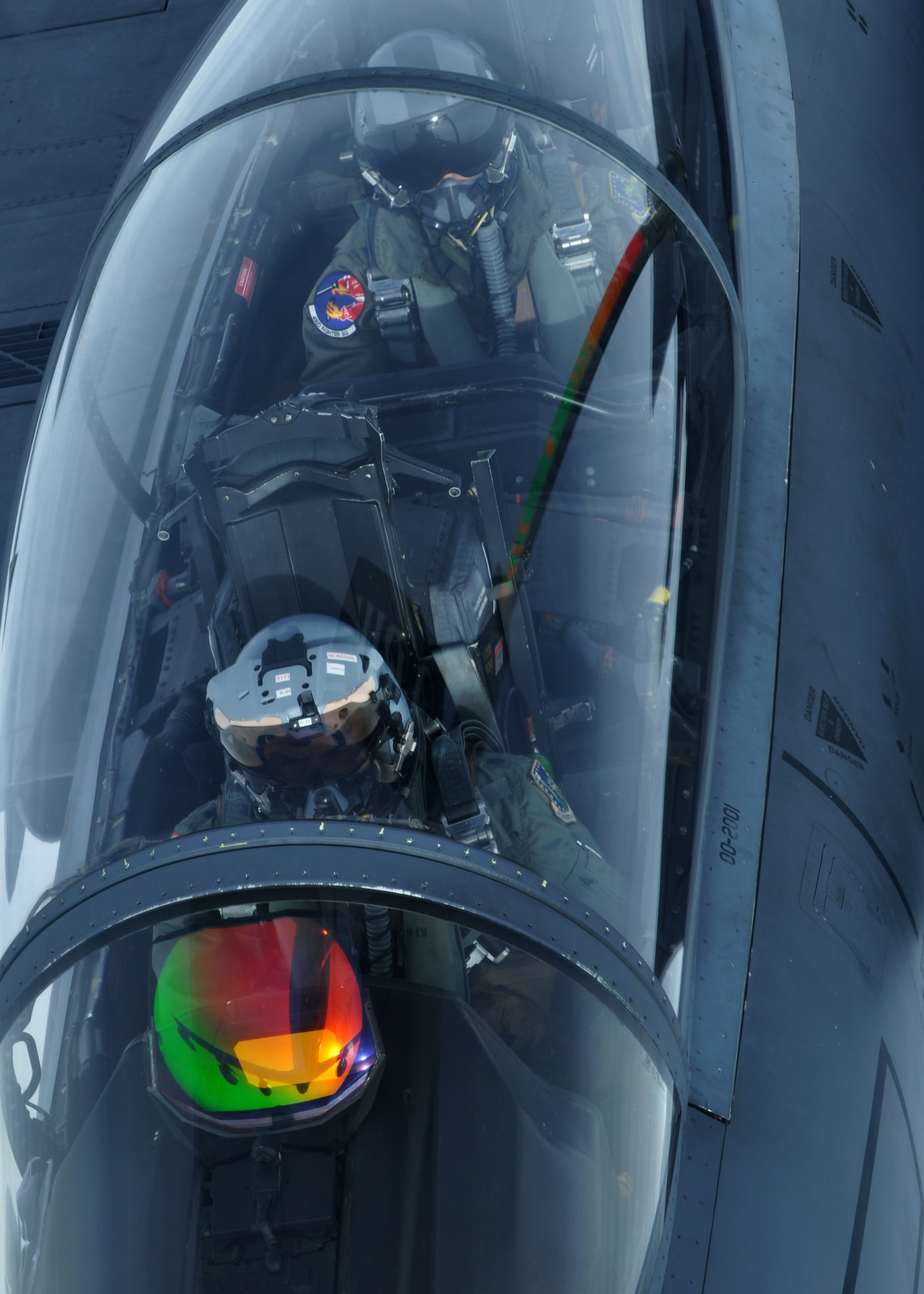 A pilot and a weapons systems operator in a U.S. Air Force F-15E Strike Eagle refuel with a KC-135R Stratotanker Sept. 17, 2013, over Norway during the Arctic Challenge exercise. The exercise afforded pilots from various European nations the chance to fly and practice aerial combat maneuvers with partner nations.
