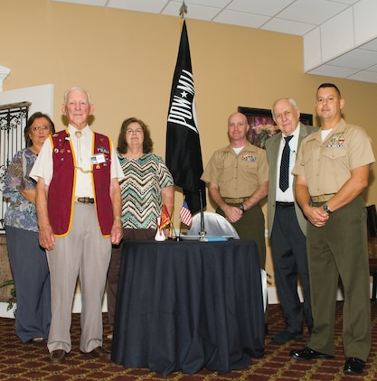 Guest speaker Maj. Alexander J. Vanston, right, commanding officer, Headquarters Company East, Marine Corps Logistics Command, stands with former Prisoners of War and family members of former POWs Friday during Marine Corps Logistics Base AlbanyÕs annual Prisoners of War/Missing in Action Recognition Breakfast, here.