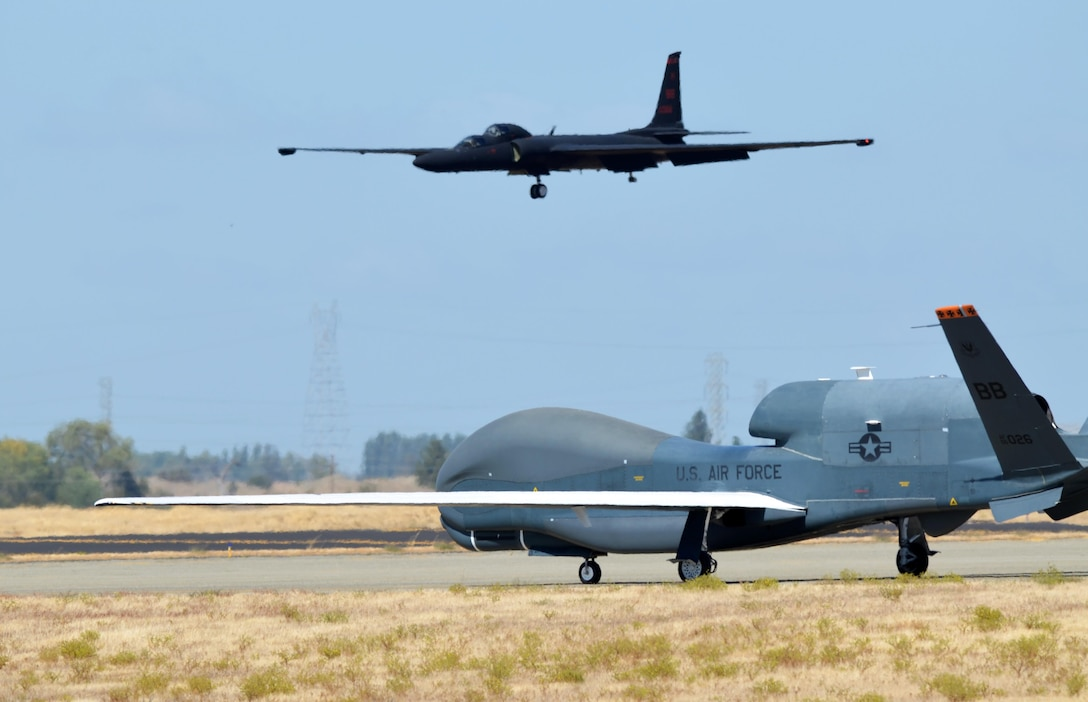 An RQ-4 Global Hawk taxies on the flightline as a U-2 makes its final approach Sept. 17, 2013, at Beale Air Force Base, Calif. The RQ-4 and U-2 are the Air Force's primary high-altitude intelligence, surveillance and reconnaissance aircraft. (U.S. Air Force photo/Airman 1st Class Bobby Cummings)