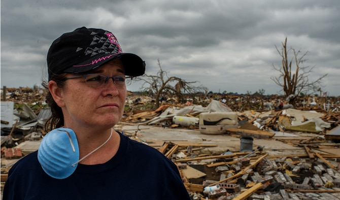 From the remnants of her former home, May 27, 2013, Tech. Sgt. Rhonda Stockstill surveys the devastation left in the wake of an EF-5 tornado that ripped through her neighborhood of Moore, Okla., on May 20. Soon after the storm passed, Stockstill rushed to provide aid to students and faculty injured and trapped in nearby Briarwood Elementary School. Stockstill is a surgical technician with the 72nd Medical Group at Tinker Air Force Base, Okla. (U.S. Air Force photo/Staff Sgt. Jonathan Snyder)