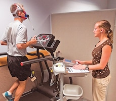 Sgt. Daniel Stoutamire, 2nd ABCT, 1st Inf. Div., left, jogs on a treadmill as Elizabeth Eser, health educator, Fort Riley Victory Center, right, runs a test to quantify his cardiovascular endurance Sept. 10.  Photo by: Sgt. Michael Leverton, 1ST INF. DIV.