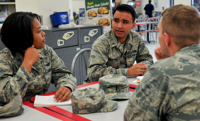 1st Lt. Tyrone Martinez, 566th Intelligence Squadron mission manager and Buckley Air Force Ball Committee president, center, speaks to members of the Air Force Ball Committee Sept. 15, 2013, at the Commissary at Buckley Air Force Base, Colo. This committee has met for more than eight months to plan the celebration of the Air Force's 66th birthday. (U.S. Air Force photo by Senior Airman Phillip Houk/Released)